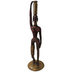 In the Styling's of Karl Hagenauer, a lovely Bronze African Woman