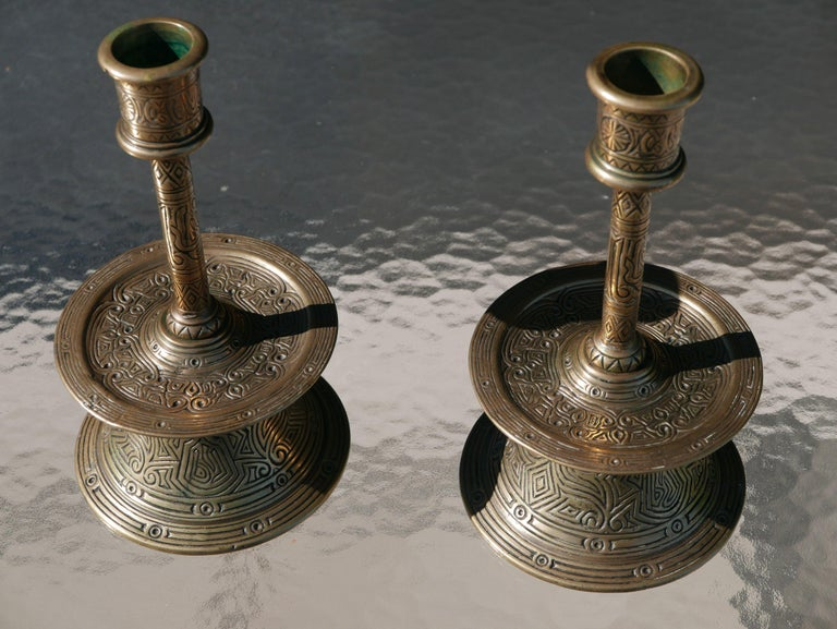 "Beautiful and rare museum quality pair of incised of 17th Century Ottoman bronze candlesticks. They are virtually identical to the one pictured on page 56, figure 61, in the book ""Old Domestic Base-Metal Candlesticks, from the 13th to 19th Century"""