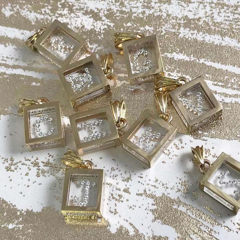 Incogem Floating Diamond Pendant: 14k Yellow Gold, available in letters A-Z. The pendants are handcrafted of recycled 14k yellow gold. The diamonds are brilliant cut, 58 facets, VS1 in clarity (G.I.A.) and H in color (G.I.A.). Each diamond weighs
