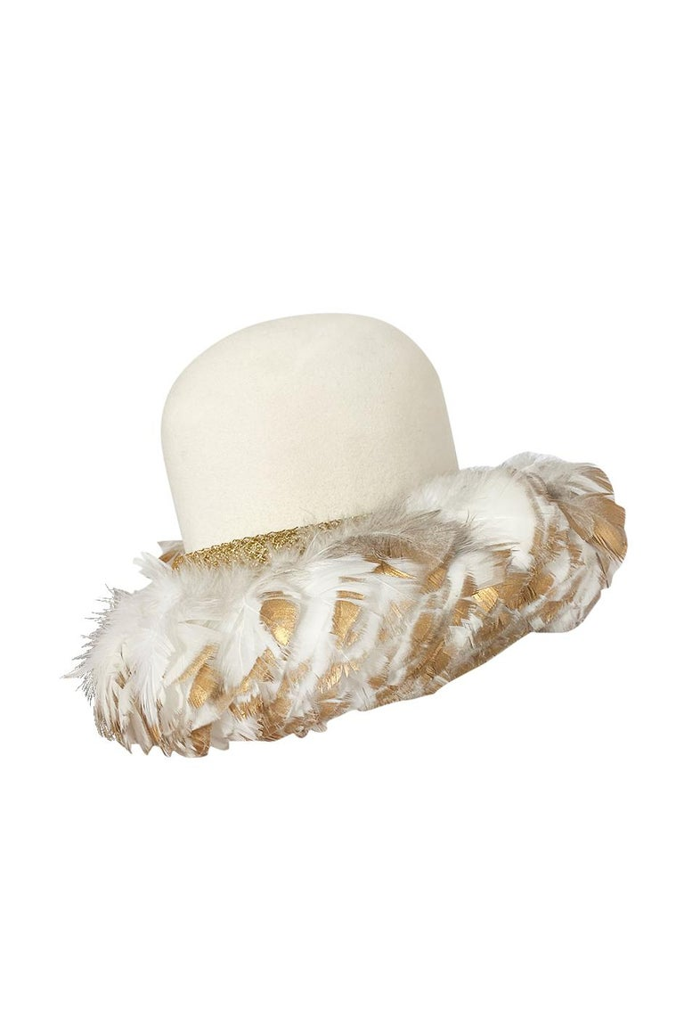 This might be one of the most incredible vintage hats I have ever had in the shop. This is by Christian Dior and it is absolutely wonderful and so very unique. The base is a fine ivory felted wool and the crown of the hat is high and rounded. It