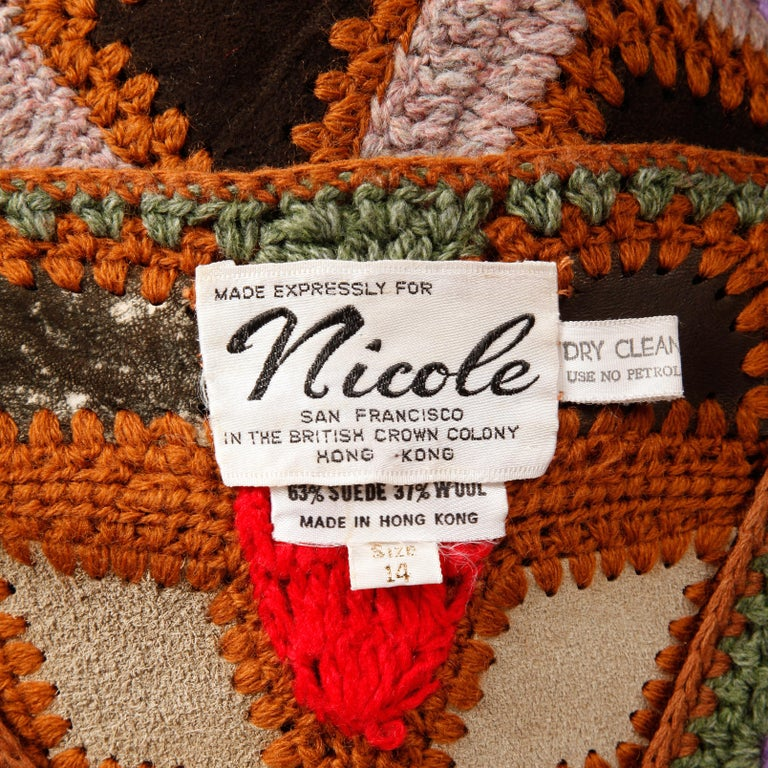 Incredible vintage 1970s colorful crochet wool vest with patchwork suede leather detailing. Unlined with front button closure. The marked size is 14, but the vest will fit most modern sizes small-medium. 63% suede, 37% wool. The bust measures 35