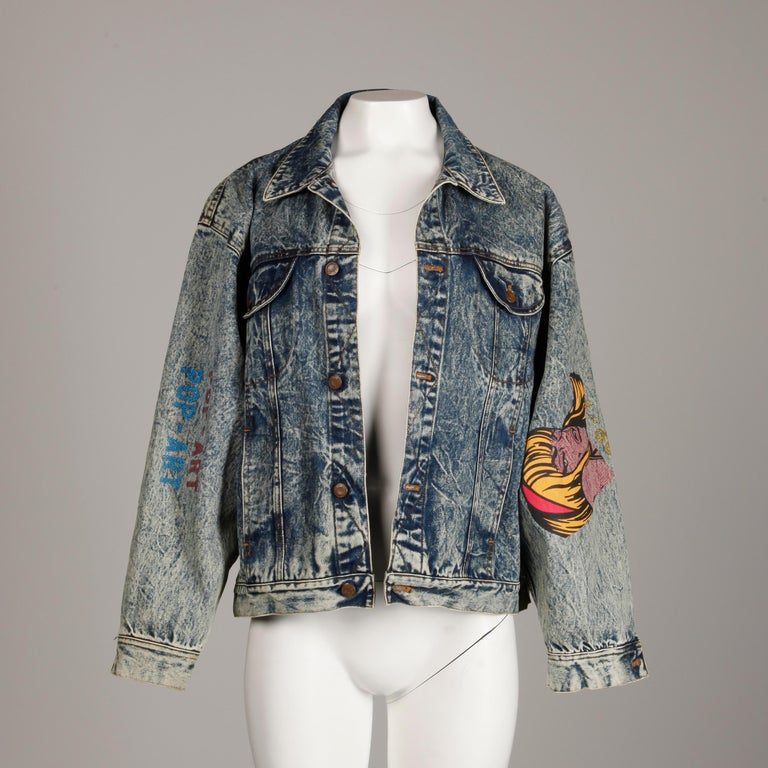 Absolutely incredible vintage 1980s pop art jacket by Et Vous with a comic book graphic and acid washed denim. Unlined with front button closure and button closure at wrists. 100% cotton. The marked size is 1, but the jacket will fit most sizes