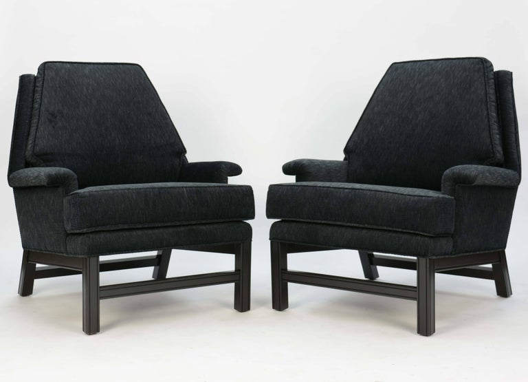 A wonderful pair of club chairs done in Henry Calvin fabric. Measures: Arm height is 20