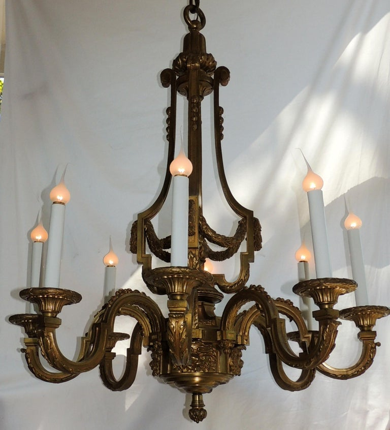 An Incredible signed Henri Vian French doré bronze neoclassical eight-light chandelier.