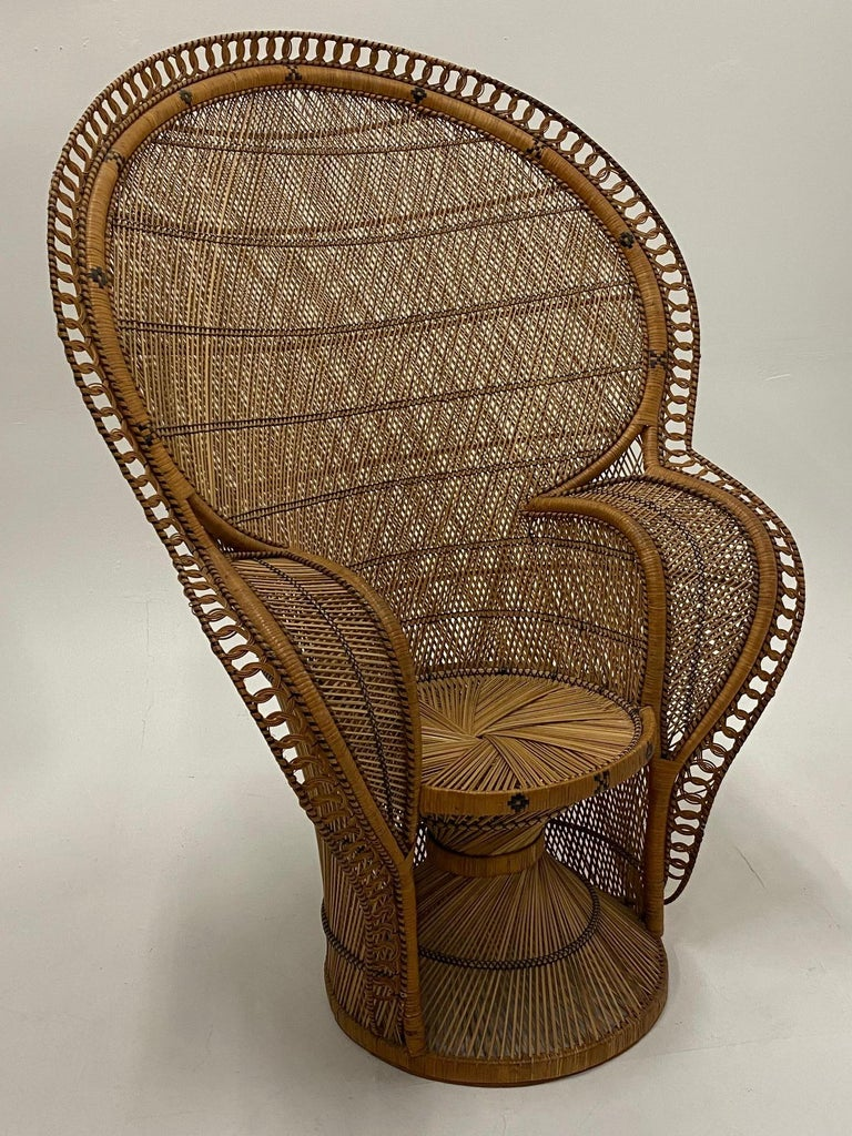 The finest one we've seen in a superb, large, and extremely detailed cobra peacock chair made of woven rattan.