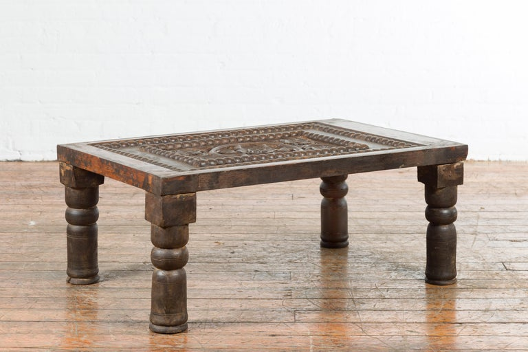 Indian 19th Century Small Wooden Coffee Table with Carved Floral Motifs In Good Condition For Sale In Yonkers, NY