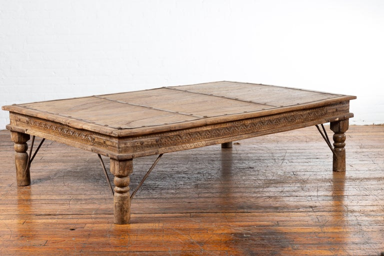 Indian 19th Century Wooden and Iron Courtyard Door Made into a Coffee Table In Good Condition For Sale In Yonkers, NY