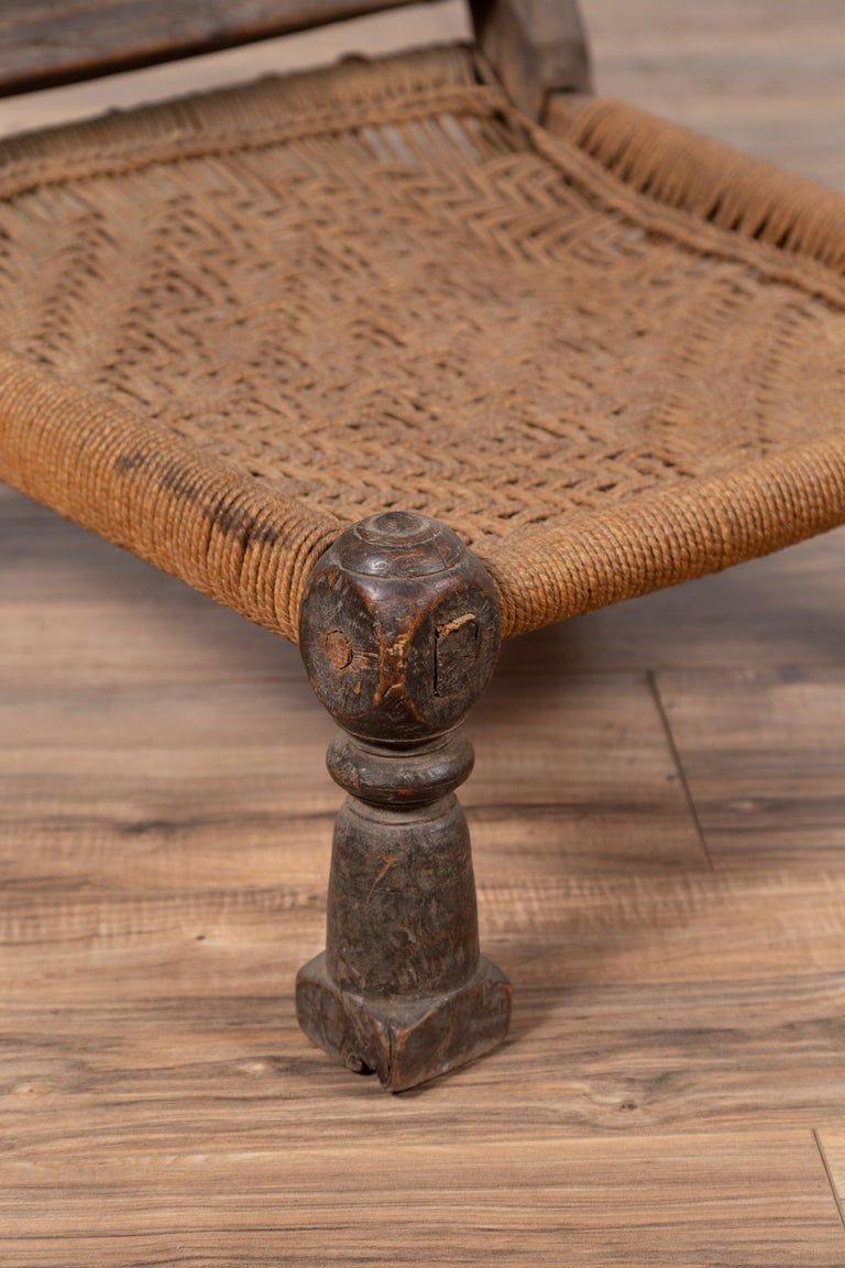 Indian Antique Rustic Low Seat Wooden Chair with Carved Rosettes and Rope Seat For Sale 5