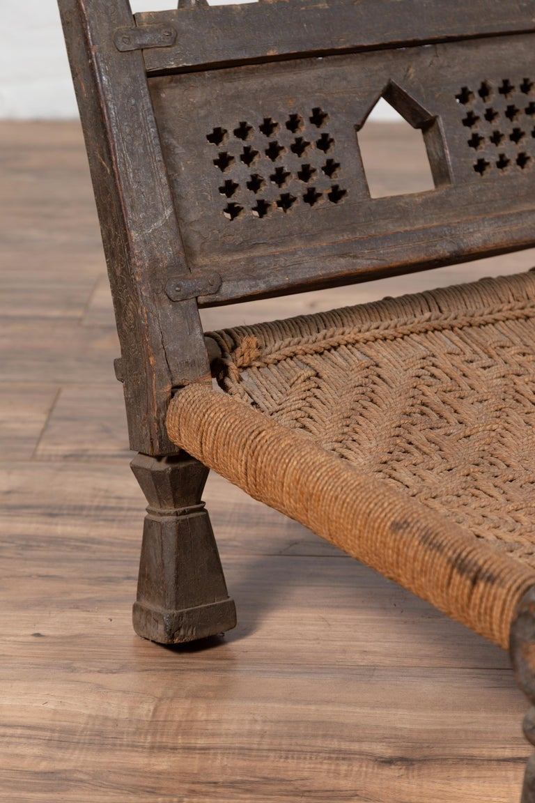 Indian Antique Rustic Low Seat Wooden Chair with Carved Rosettes and Rope Seat For Sale 6