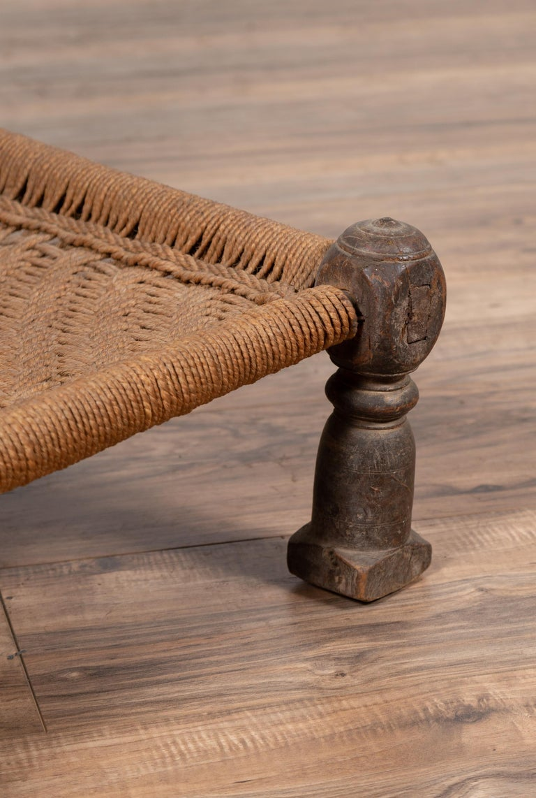 Indian Antique Rustic Low Seat Wooden Chair with Carved Rosettes and Rope Seat For Sale 7