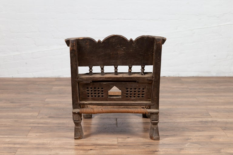 Indian Antique Rustic Low Seat Wooden Chair with Carved Rosettes and Rope Seat For Sale 9