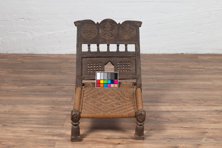 Indian Antique Rustic Low Seat Wooden Chair with Carved Rosettes and Rope Seat For Sale 11