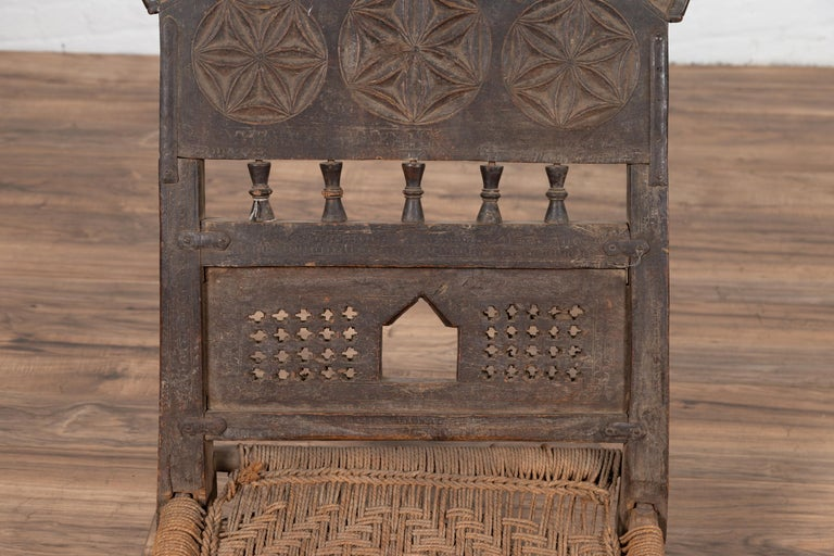 Indian Antique Rustic Low Seat Wooden Chair with Carved Rosettes and Rope Seat For Sale 1