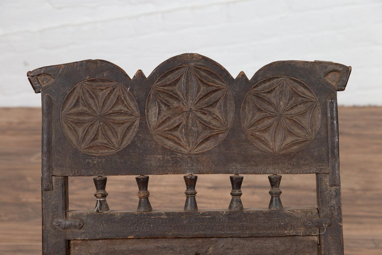 Indian Antique Rustic Low Seat Wooden Chair with Carved Rosettes and Rope Seat For Sale 2
