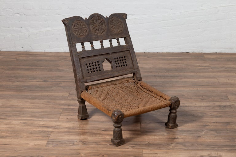 Indian Antique Rustic Low Seat Wooden Chair with Carved Rosettes and Rope Seat For Sale 3