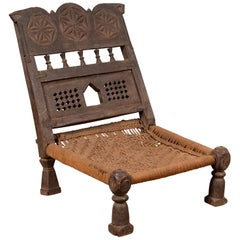 Indian Antique Rustic Low Seat Wooden Chair with Carved Rosettes and Rope Seat