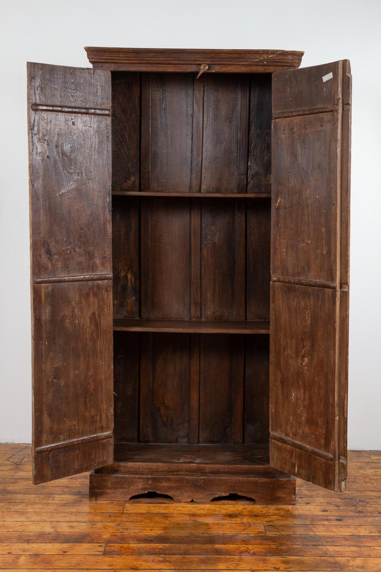 Indian Antique Wooden Armoire with Paneled Doors, Metal Braces and Aged Patina For Sale 10