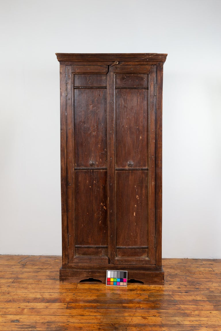 Indian Antique Wooden Armoire with Paneled Doors, Metal Braces and Aged Patina For Sale 12