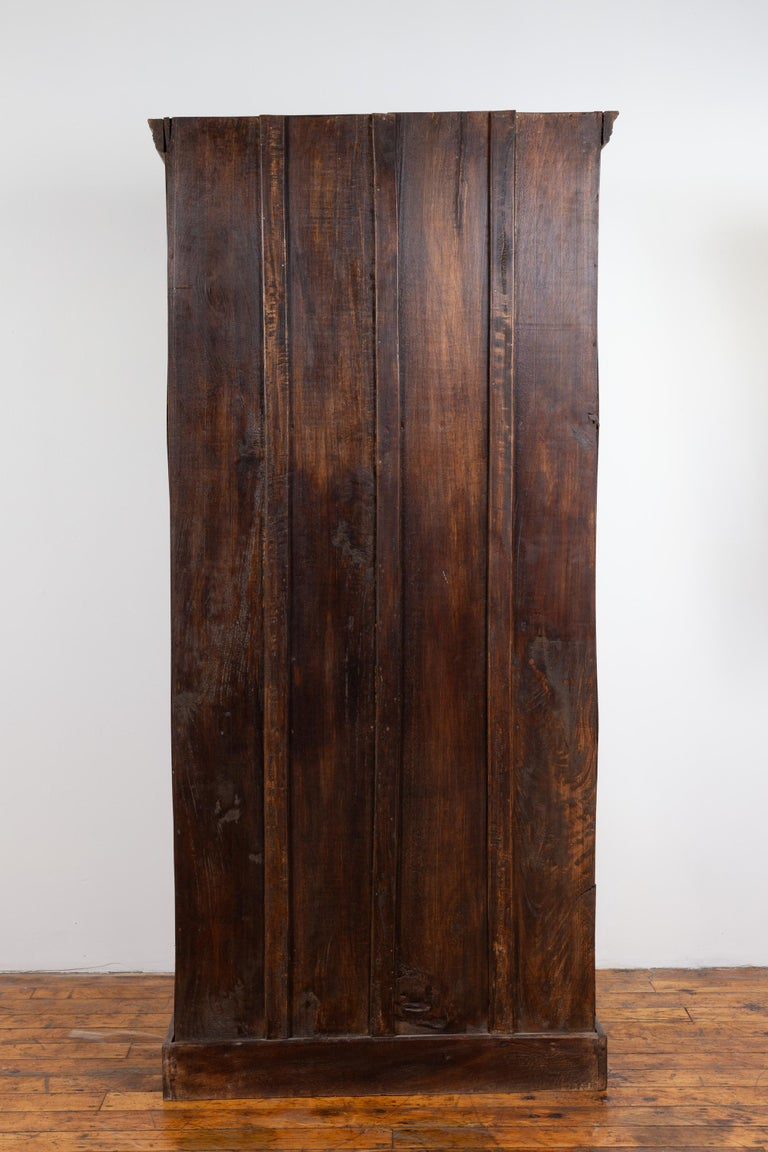 Indian Antique Wooden Armoire with Paneled Doors, Metal Braces and Aged Patina For Sale 14