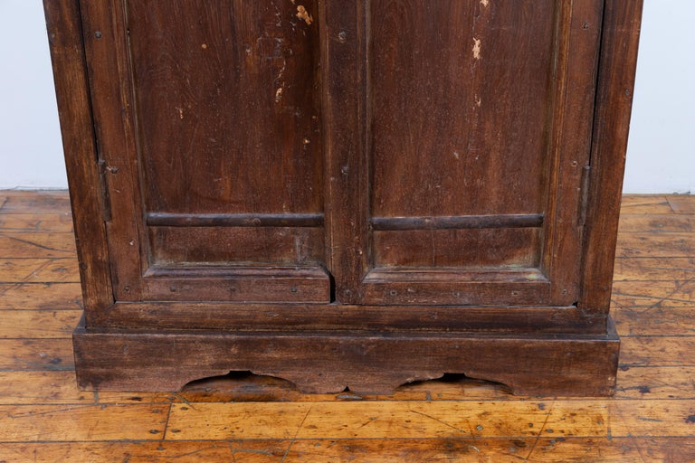Indian Antique Wooden Armoire with Paneled Doors, Metal Braces and Aged Patina For Sale 2