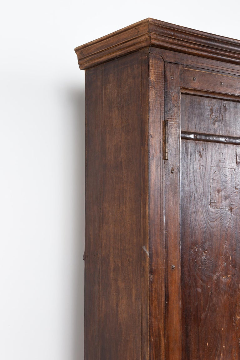 Indian Antique Wooden Armoire with Paneled Doors, Metal Braces and Aged Patina For Sale 4