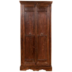 Indian Antique Wooden Armoire with Paneled Doors, Metal Braces and Aged Patina