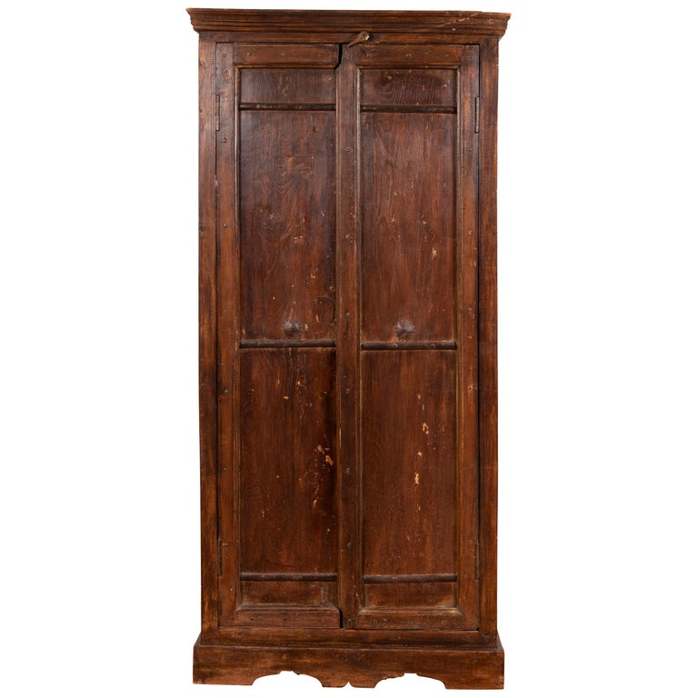 Indian Antique Wooden Armoire with Paneled Doors, Metal Braces and Aged Patina For Sale