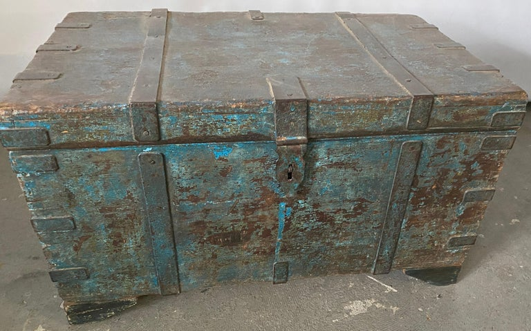 Wonderfully painted rustic Indian trunk or blanket chest with great hardware. Perfect for foot of the bed, use for coffee table, toy storage or entry hallway bench. Place the blanket chest at the bottom of a bed or in a mud room and add a cushion