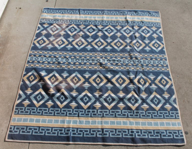 This fine all cotton Indian design camp blanket is in great condition with minor fade spots on the reverse side. Note as seen in additional photos the small fade spots. The blanket is mint condition otherwise with the original binding edge. Blue and