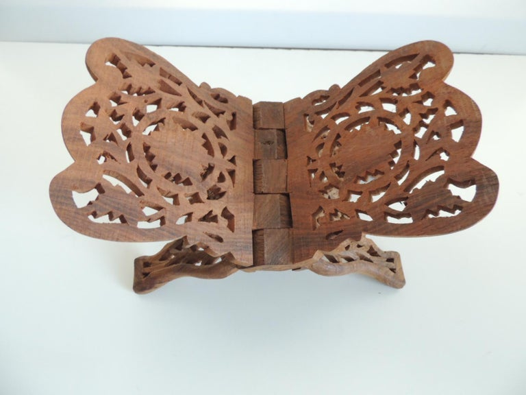 Folding Indian hand carved book display or stand. Size: 11