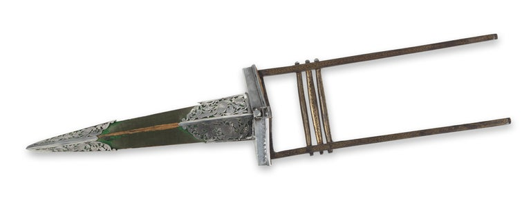 An Indian Punch-dagger Katar, and Scabbard  Mughal, late 18th century  The hilt decorated with gold inlays, the steel blade inlaid in gold with what appears to be a poem in Urdu, the wooden scabbard overlaid with green velvet and having openwork