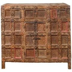 Indian Rubbed Wood Palace Cabinet with Carved Floral Decor and Red Patina