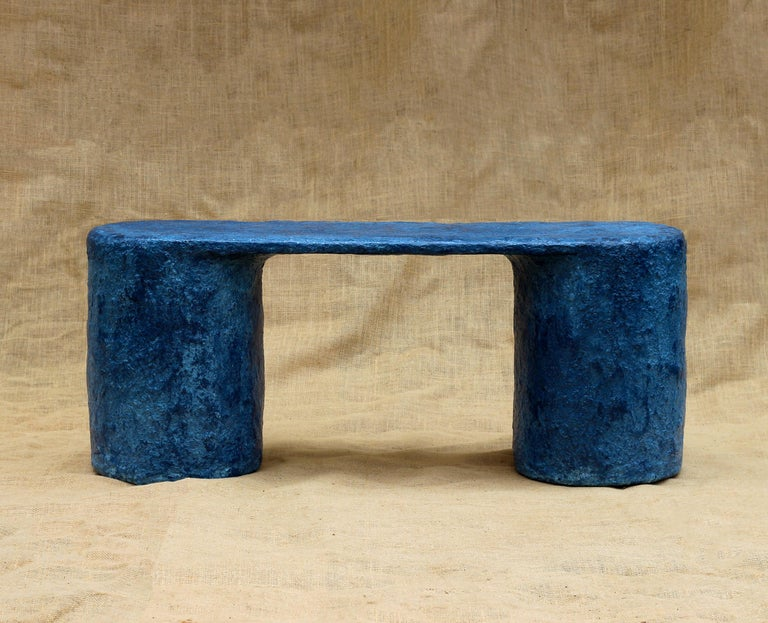 Two-legged bench, handmade in New York.  The Pulp collection by New York–based Serra Studio arose from a series of experiments testing the structural integrity of recycled paper pulp as a medium. The collection references the largely forgotten