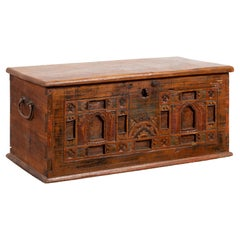 Indonesian 19th Century Blanket Chest with Carved Motifs and Lateral Handles