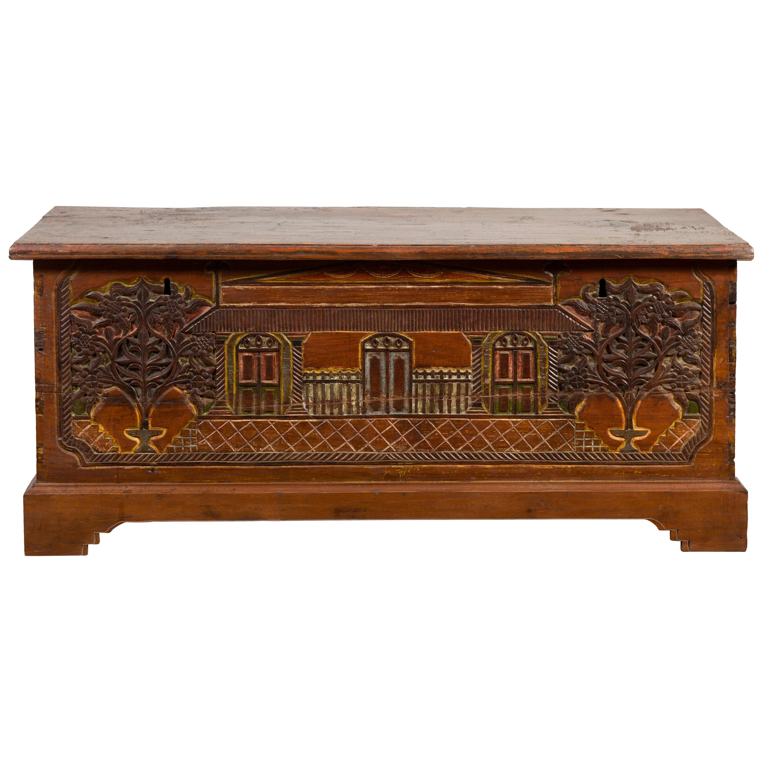 Indonesian 19th Century Carved and Painted Trunk with Architecture and Foliage