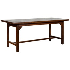 Indonesian 20th Century Table with Dark Brown Patina and H-Form Stretcher