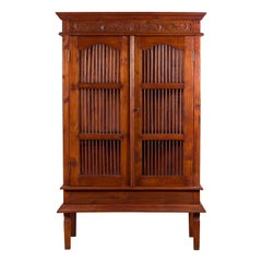 Indonesian Early 20th Century Openwork Cabinet with Carved Scrolling Foliage