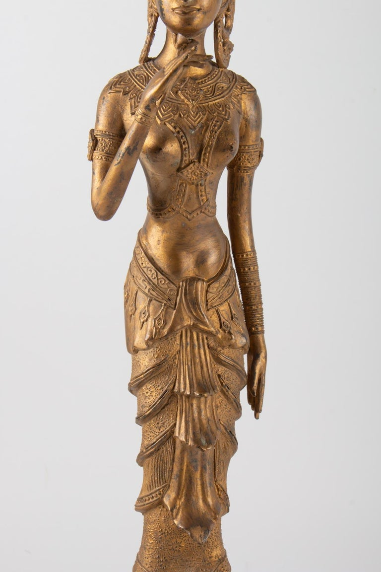 Chinese Export Indonesian Goddess in Gilded Metal Holding a Lotus Flower, 1920-1940 For Sale