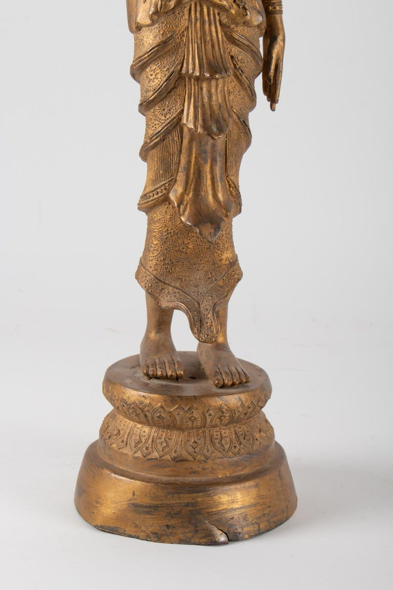 Asian Indonesian Goddess in Gilded Metal Holding a Lotus Flower, 1920-1940 For Sale