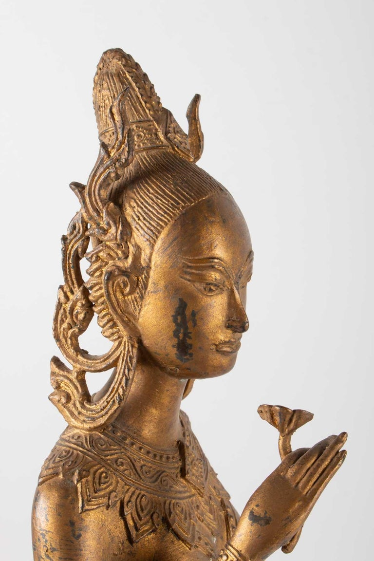 Indonesian Goddess in Gilded Metal Holding a Lotus Flower, 1920-1940 In Good Condition For Sale In Saint-Ouen, FR