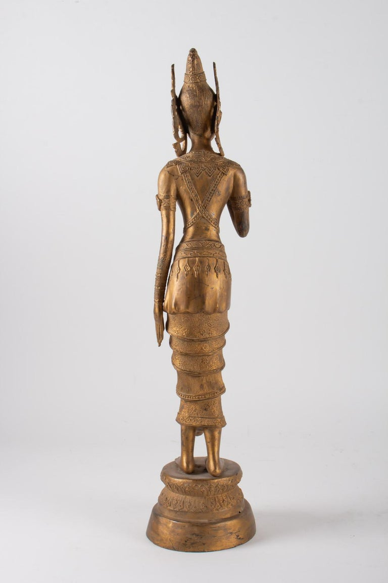 Indonesian Goddess in Gilded Metal Holding a Lotus Flower, 1920-1940 For Sale 1