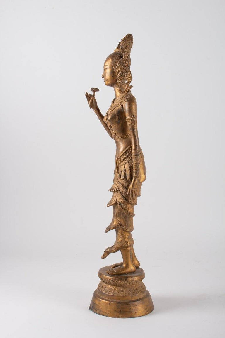 Indonesian Goddess in Gilded Metal Holding a Lotus Flower, 1920-1940 For Sale 2