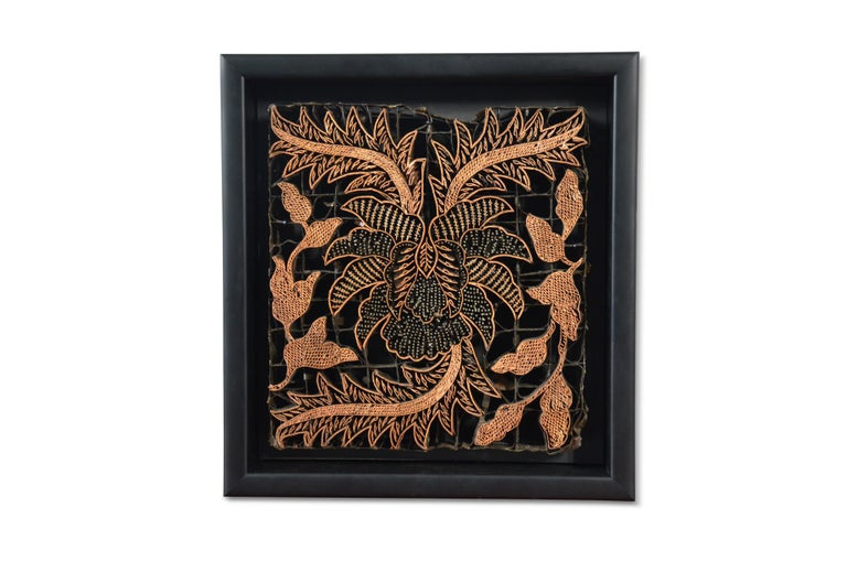 A vintage Indonesian copper Batik textile printing block from the mid 20th century, mounted in a black shadow box. Created in Indonesia, this copper stamp was used by Batik artists to create ornate motifs by dipping it in hot wax and applying it on