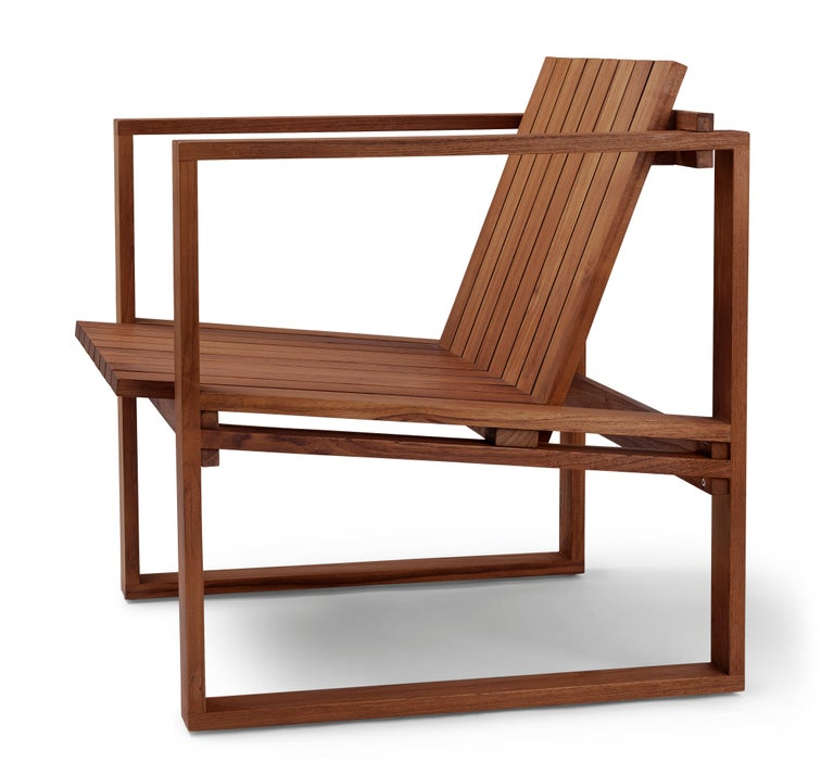 The BK11 lounge chair was designed in 1959 by Danish architect Bodil Kjær as part of her architecturally inspired Indoor-Outdoor series. With a linear form influenced by Cubism, the chair's solid teak construction is designed to patinate beautifully