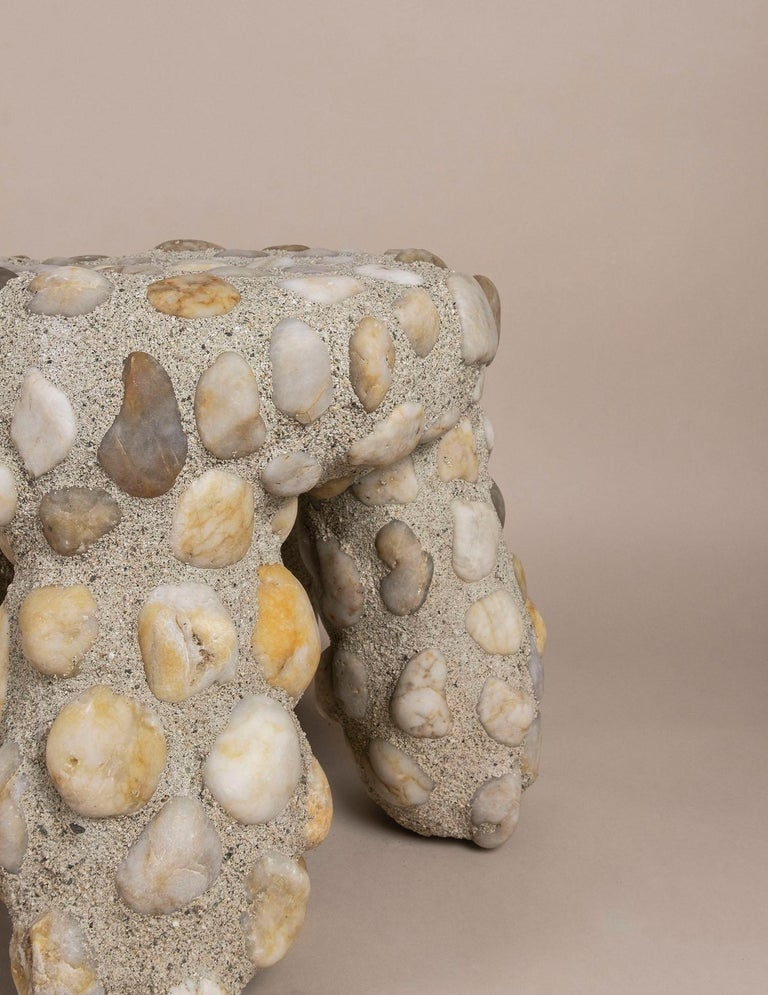 The Masonry Tuffet stool is made from a common injection molded plastic child's stool, reimagined by cladding it in stone masonry. This piece represents the artist's personal appreciation for the physical characteristics, permanence, and