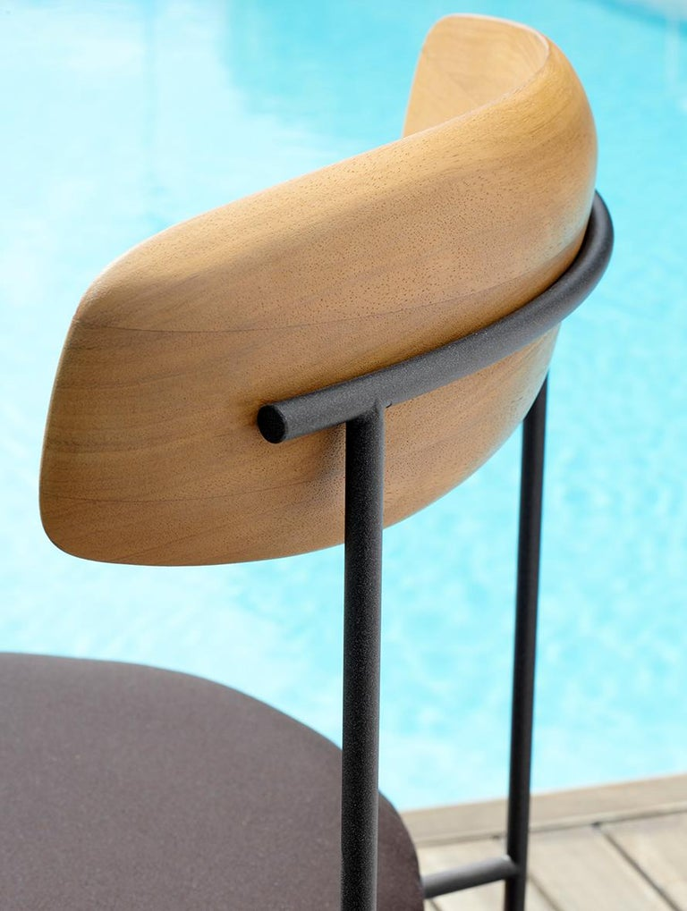 """Chair with removable cover structure in embossed metal rod, backrest in Iroko and seat padded in polyurethane foam.   Dimensions: W 22.04'' x D 19.07 x H 32.05"""" x seat H 17.07 Frame finish: Ava embossed metal Backrest finish: Iroko wood."""