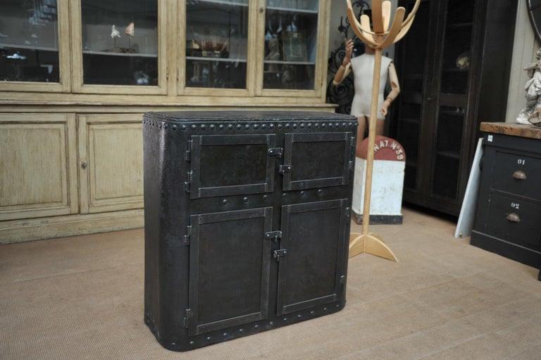 Industrial 4 doors cabinet in riveted iron, circa 1900.