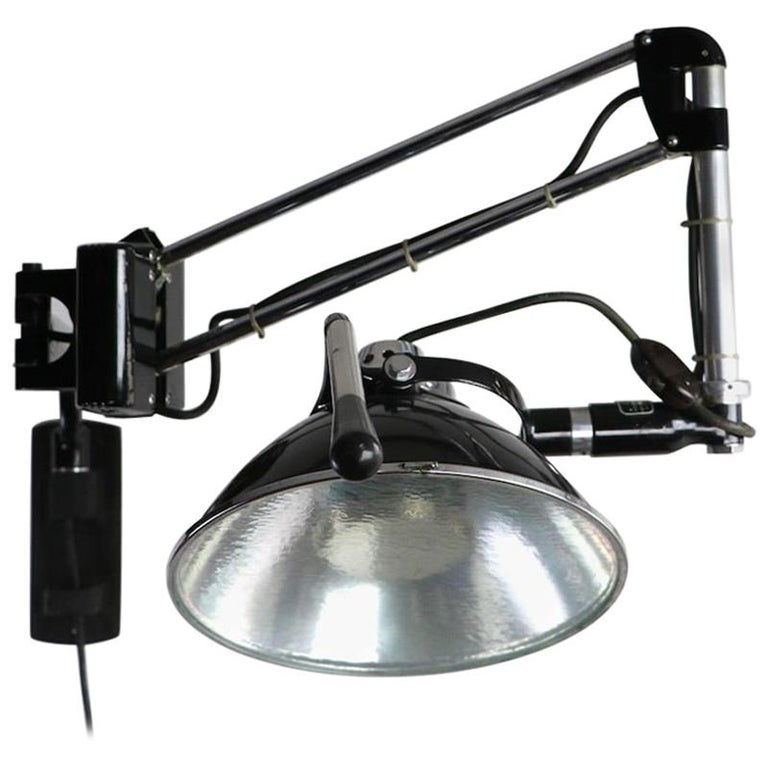 Industrial Adjustable Wall Mount Dental Light by the Wilmont Castle Co. For Sale