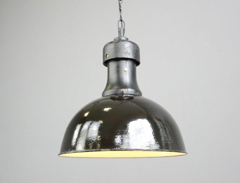 Industrial Bauhaus light by AEG, Circa 1920s.  - Vitreous black enamel shade - Cast iron top stamped