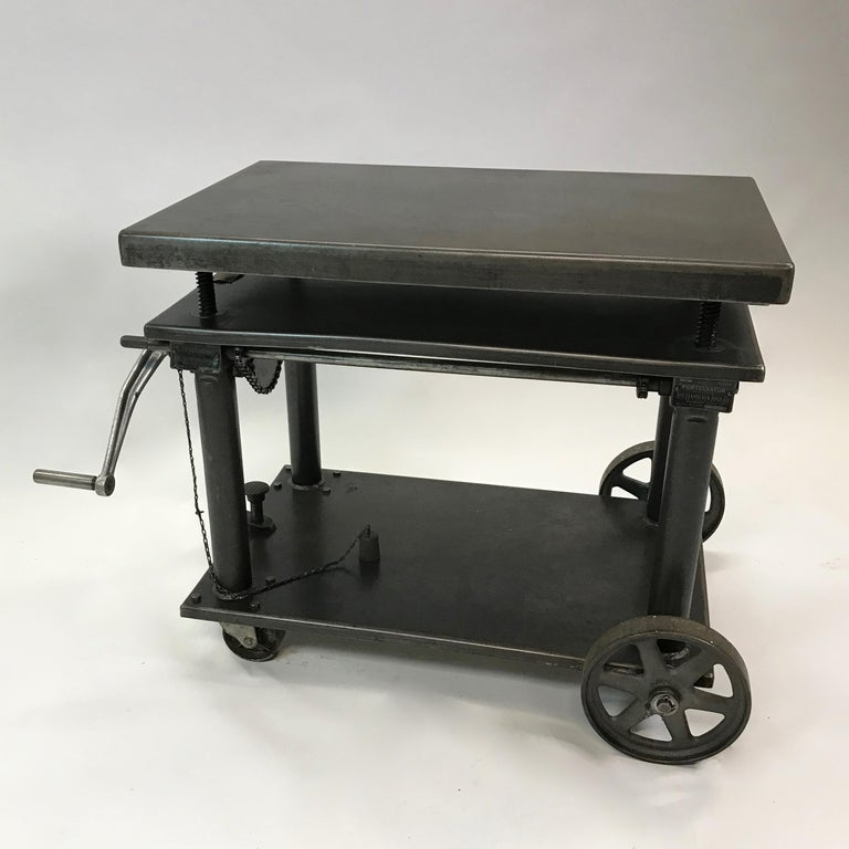 American Industrial, fully functional, iron and steel, heavily reinforced, hand-crank, mobile factory cart or die table manufactured by Hamilton Tool Co., Hamilton, Oh. is height is adjustable from 25 - 39 inches. This portable elevating table or